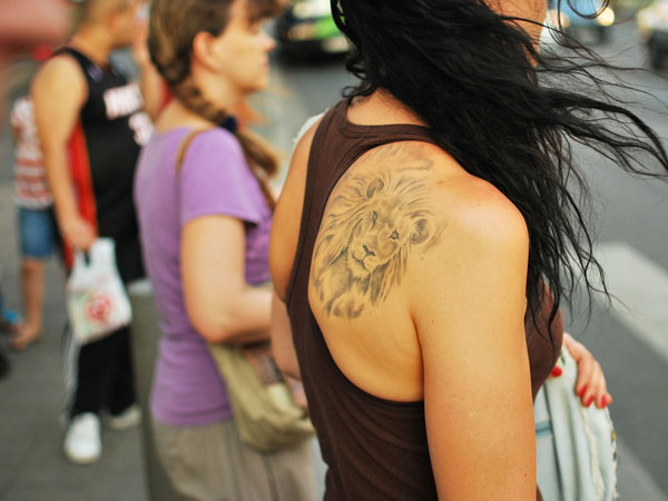 lion-head-tattoo-for-girl-on-back